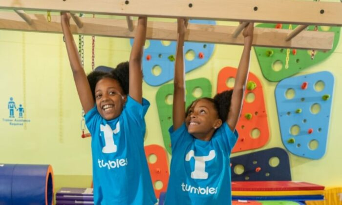 children exercises in tumbles playground